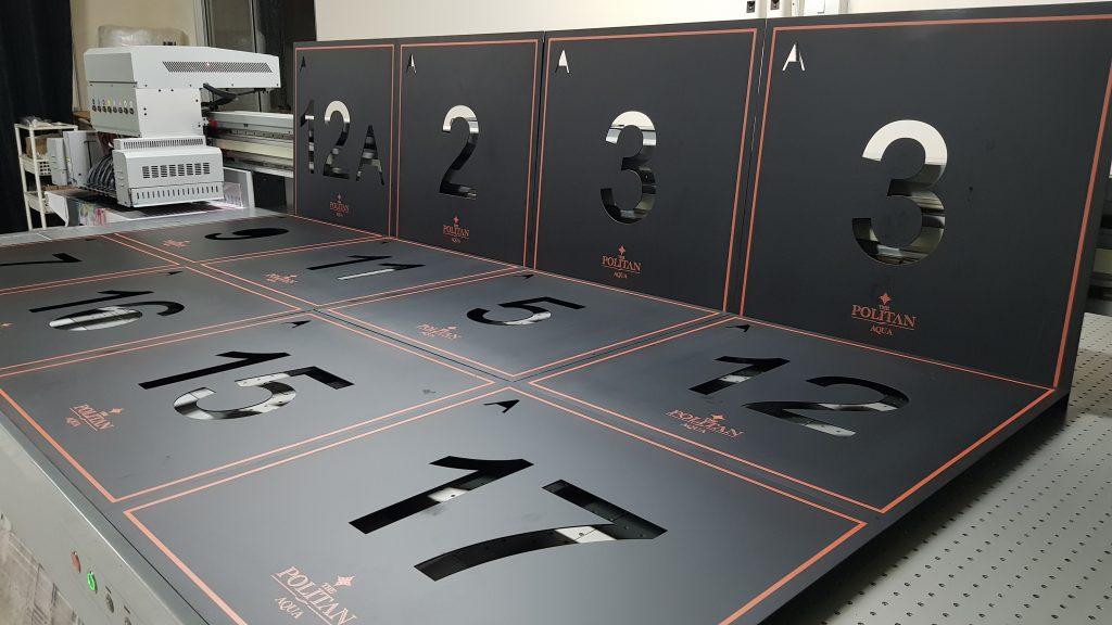 พิมพ์ป้ายโครงการคอนโด เหล็กชุบซิงค์ดำ